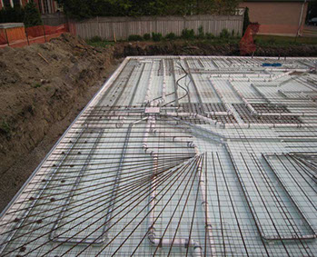 Insulated slab on grade foundation forms radiant heated for Slab on grade ontario